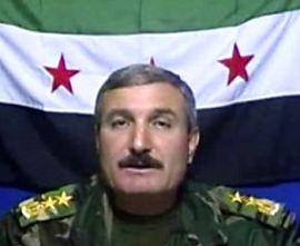 pemimpin pemberontak suriah Riad Al-Assaad